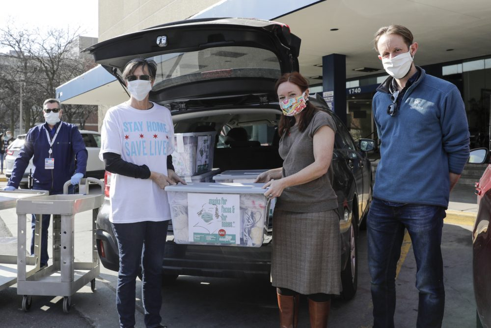 Chicago's First Lady Amy Eshleman, left, helps Rebecca Rugg, dean of the College of Architecture, Design and the Arts, and Chris Plevin of the Chicago Shakespeare Theater, deliver 5,000 fabric face masks to the University of Illinois Hospital on April 3.