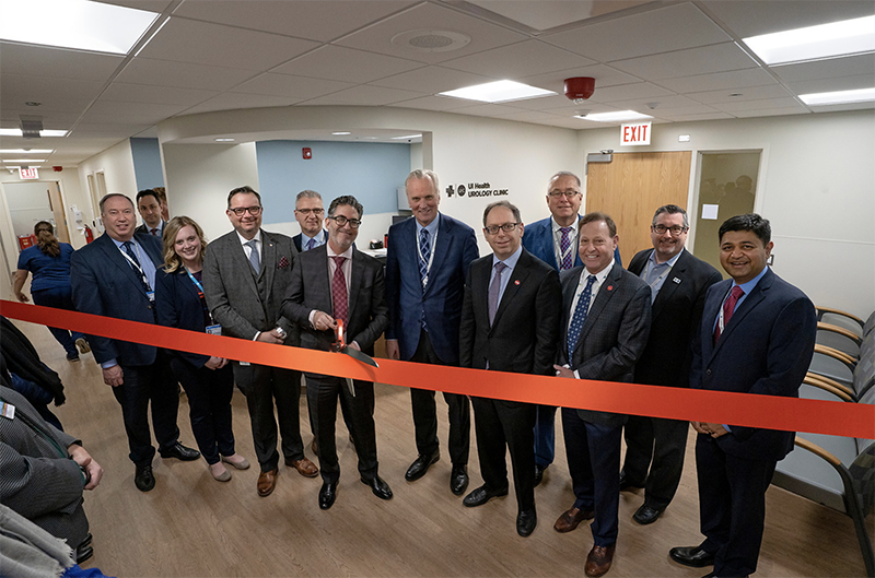 Dr. Craig S. Niederberger, head of the Department of Urology, is joined by department and UI Health leadership as he prepares to cut the ribbon for the ceremonial opening of the new Urology clinic Jan. 17.